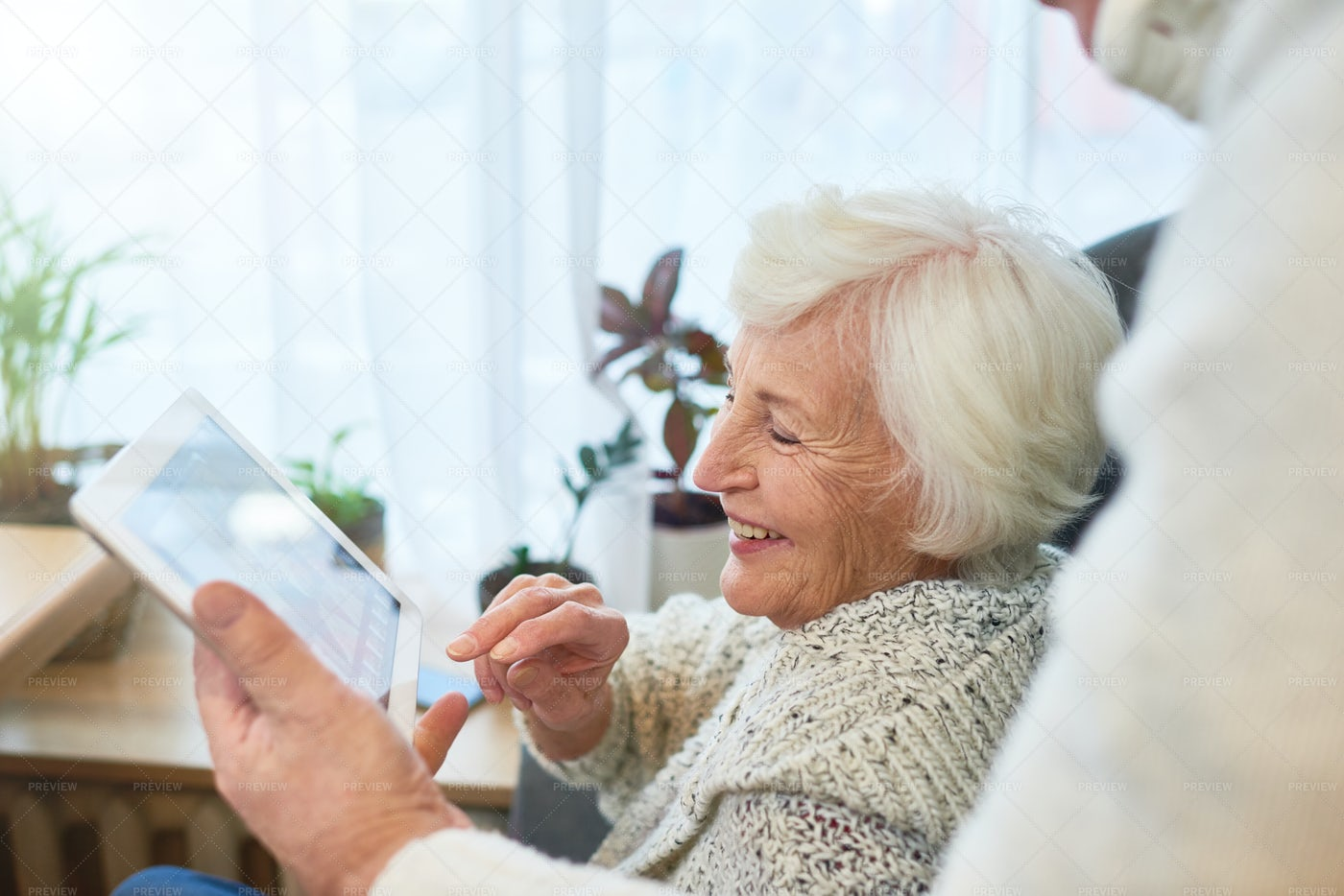 Laughing Elderly Lady Using Tablet: Stock Photos