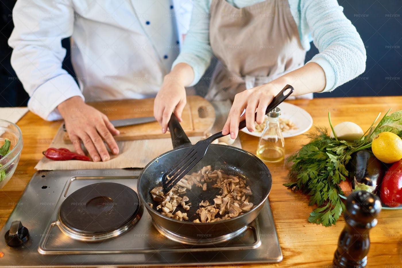 Frying Mushrooms At Cooking...: Stock Photos