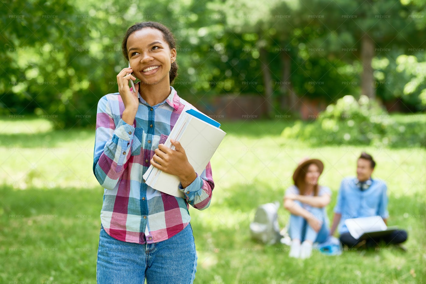 Cheerful African  Student Speaking...: Stock Photos