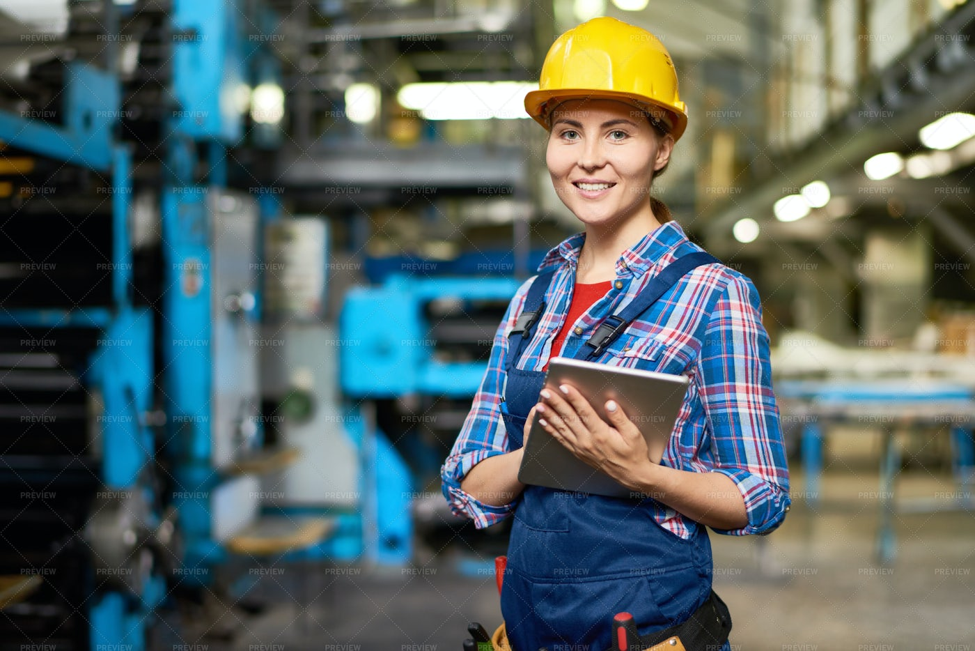 Happy Young Woman At Factory: Stock Photos