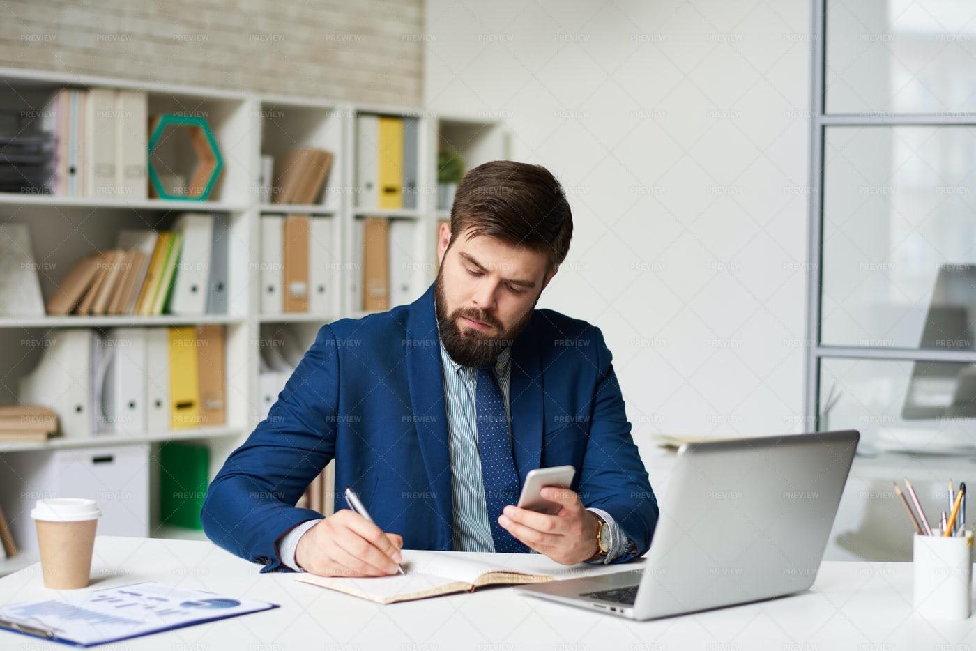Modern Businessman Working In...: Stock Photos