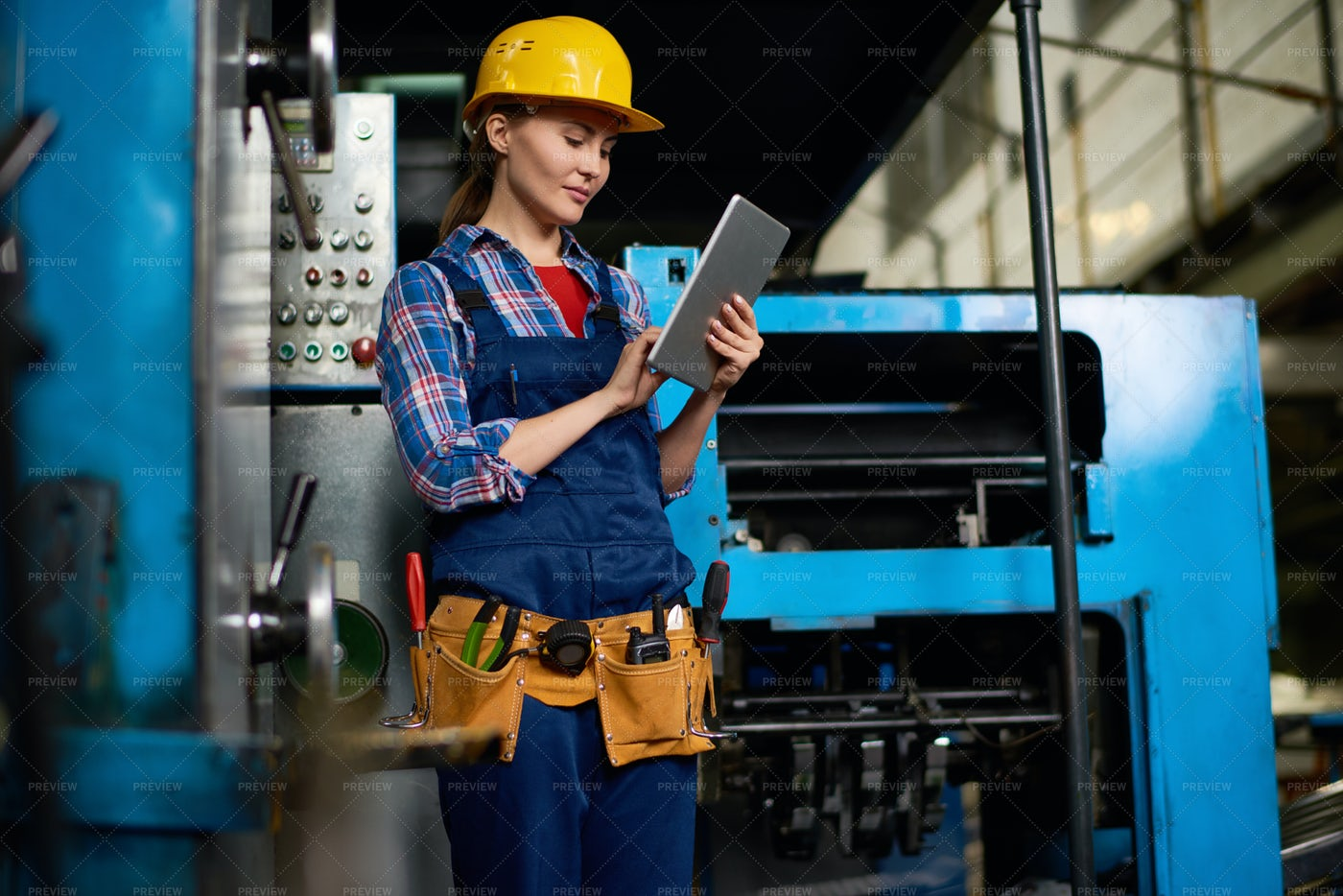 Female Technician Working At...: Stock Photos