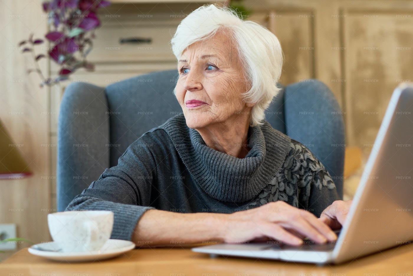 Elegant Senior Woman Using Laptop: Stock Photos