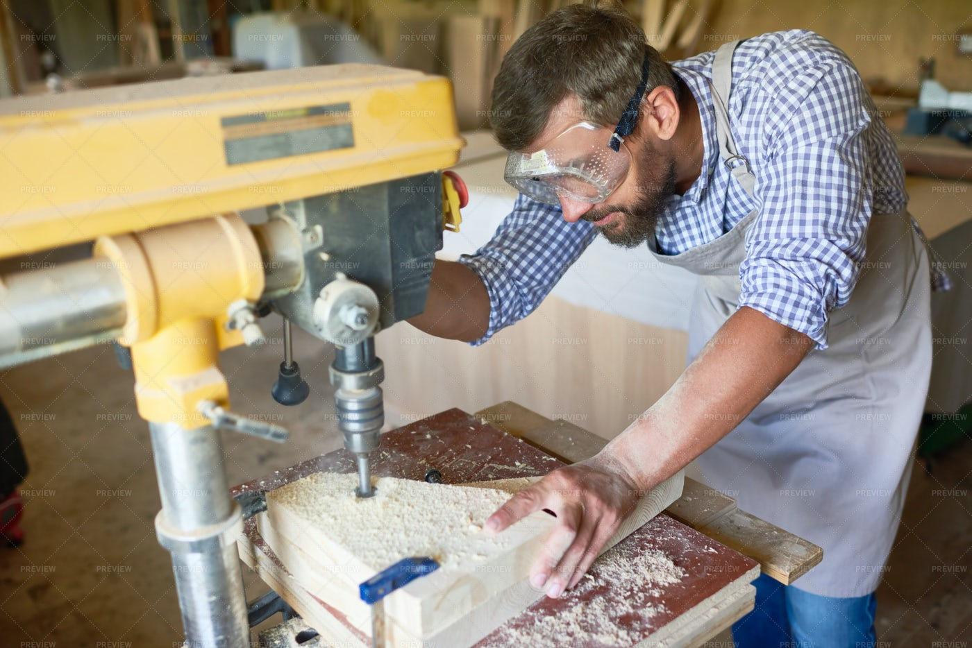 Bearded Carpenter Working In...: Stock Photos