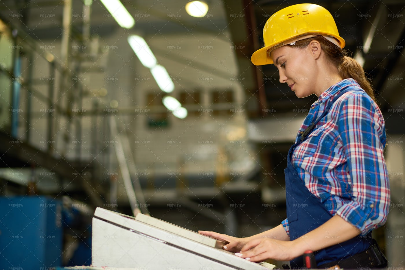 Young Woman Operating Machine Units...: Stock Photos