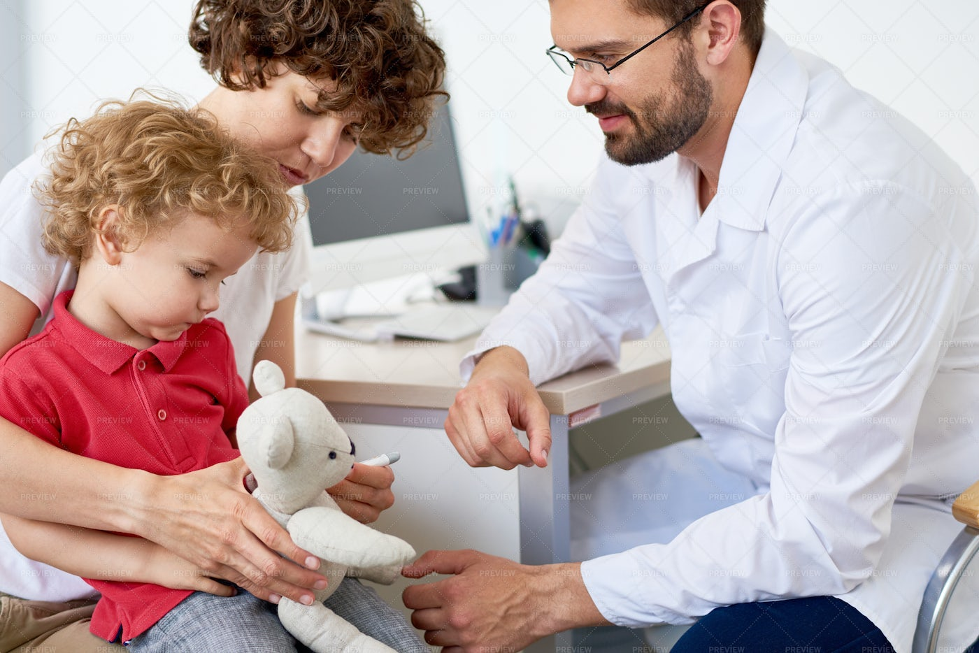 Examining Curly Little Patient: Stock Photos