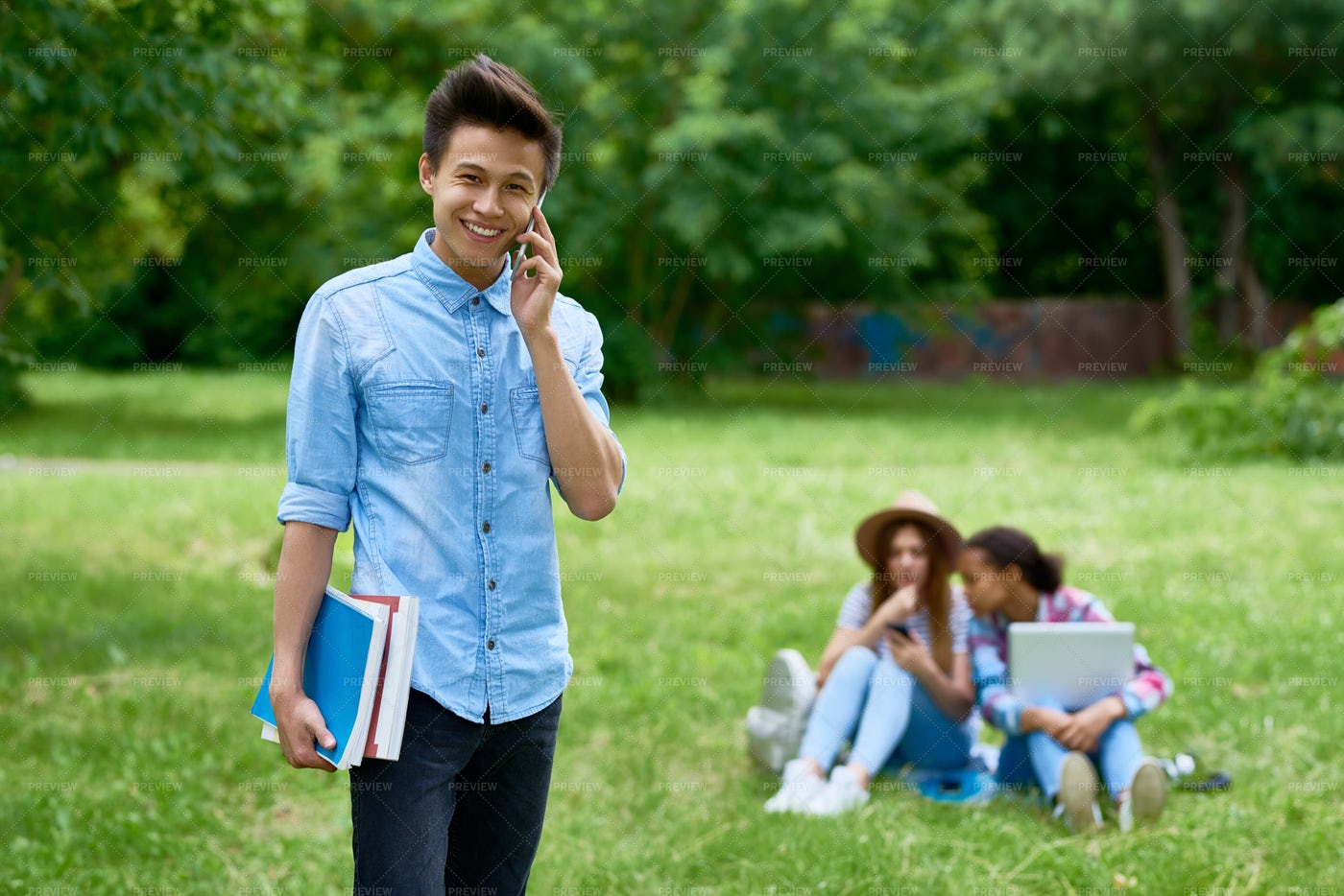 Cheerful Asian Student On Campus...: Stock Photos