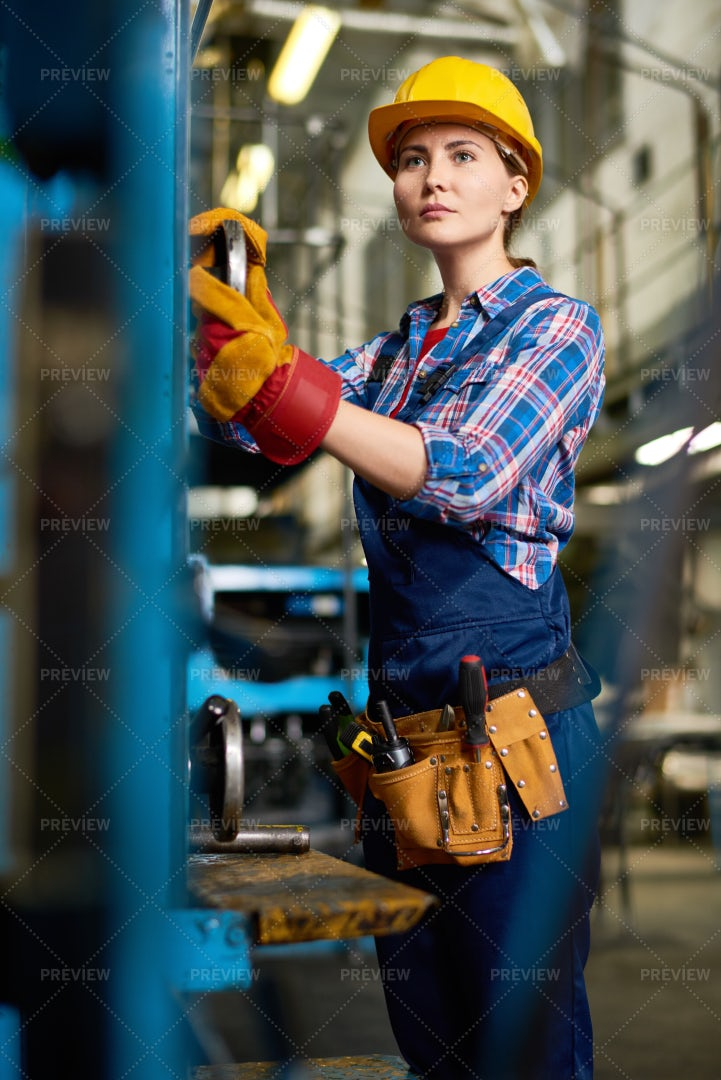 Young Woman Operating Machines In ...: Stock Photos