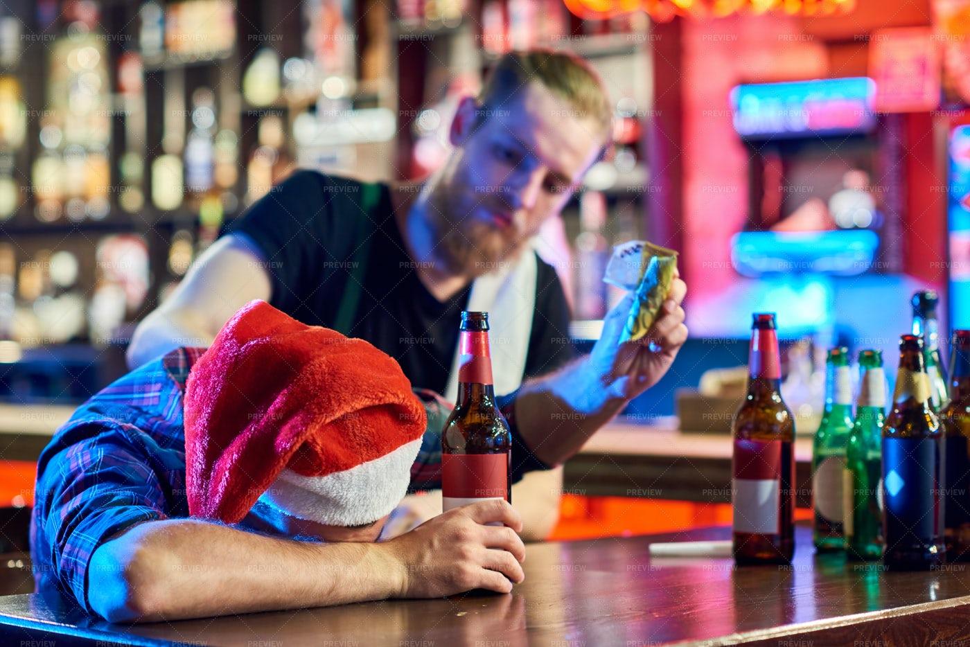 Drunk Man At Christmas Party In Bar: Stock Photos