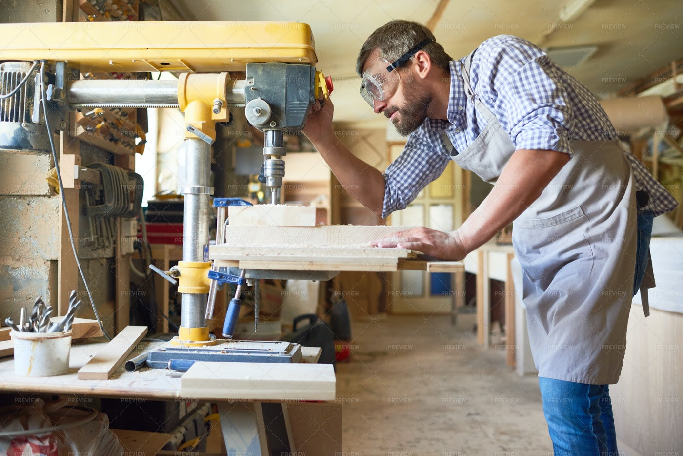 Skilled Carpenter Working In...: Stock Photos