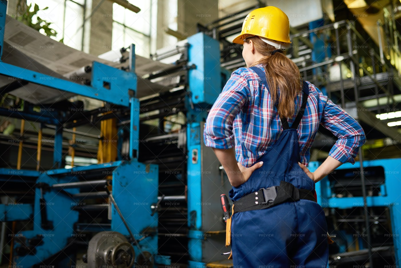 Female Factory Worker Supervising...: Stock Photos