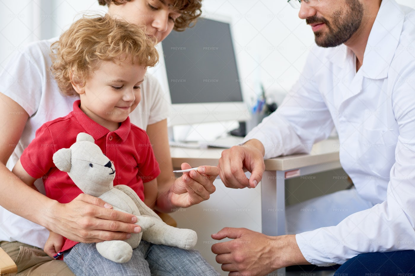 Checking Temperature Of Little Son: Stock Photos