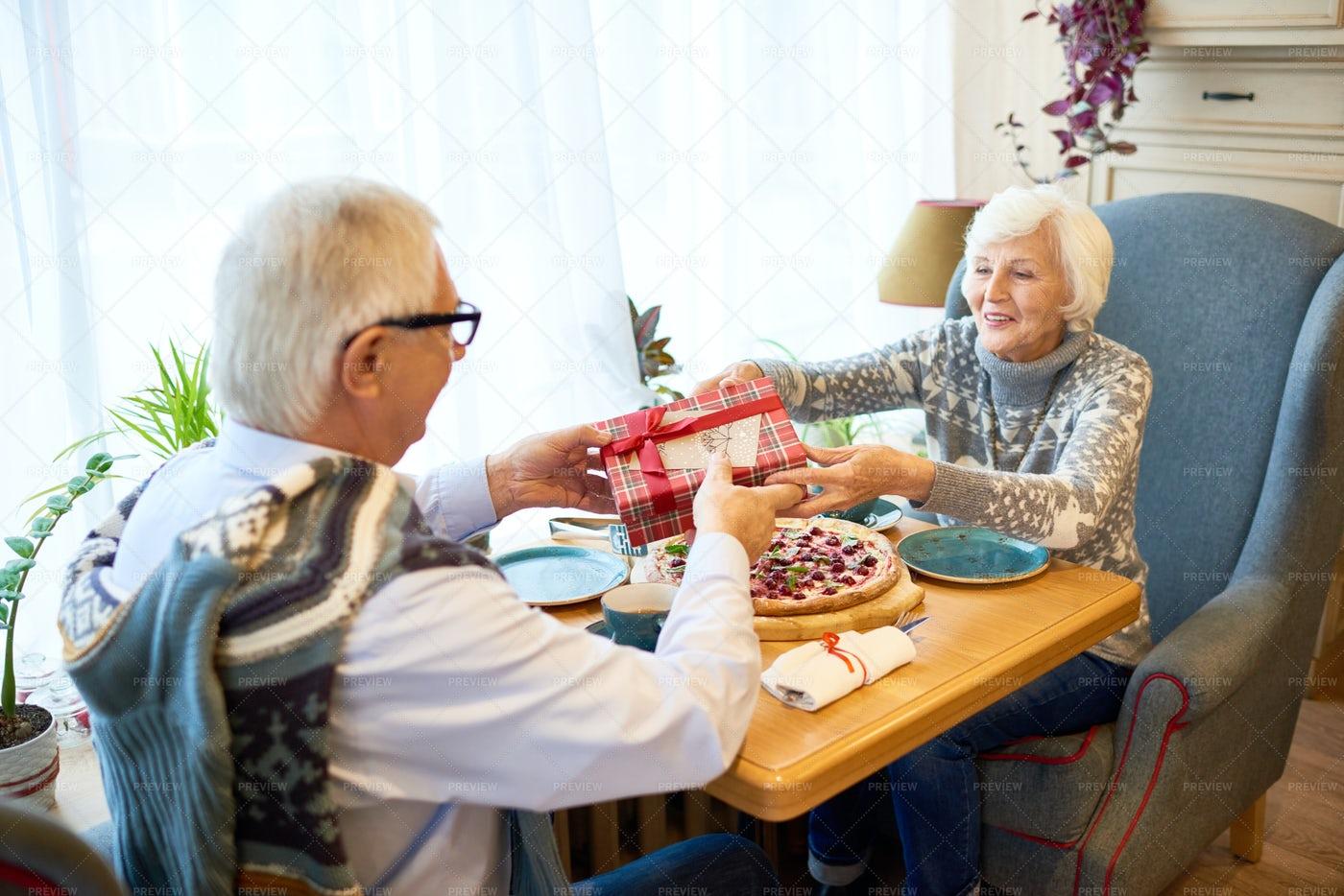 Senior Couple Exchanging Gifts: Stock Photos