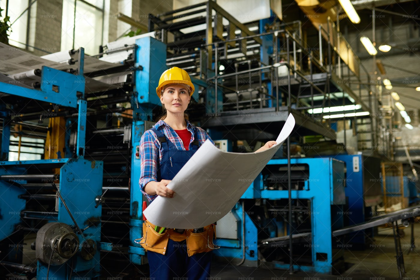 Female Factory Worker In Modern...: Stock Photos