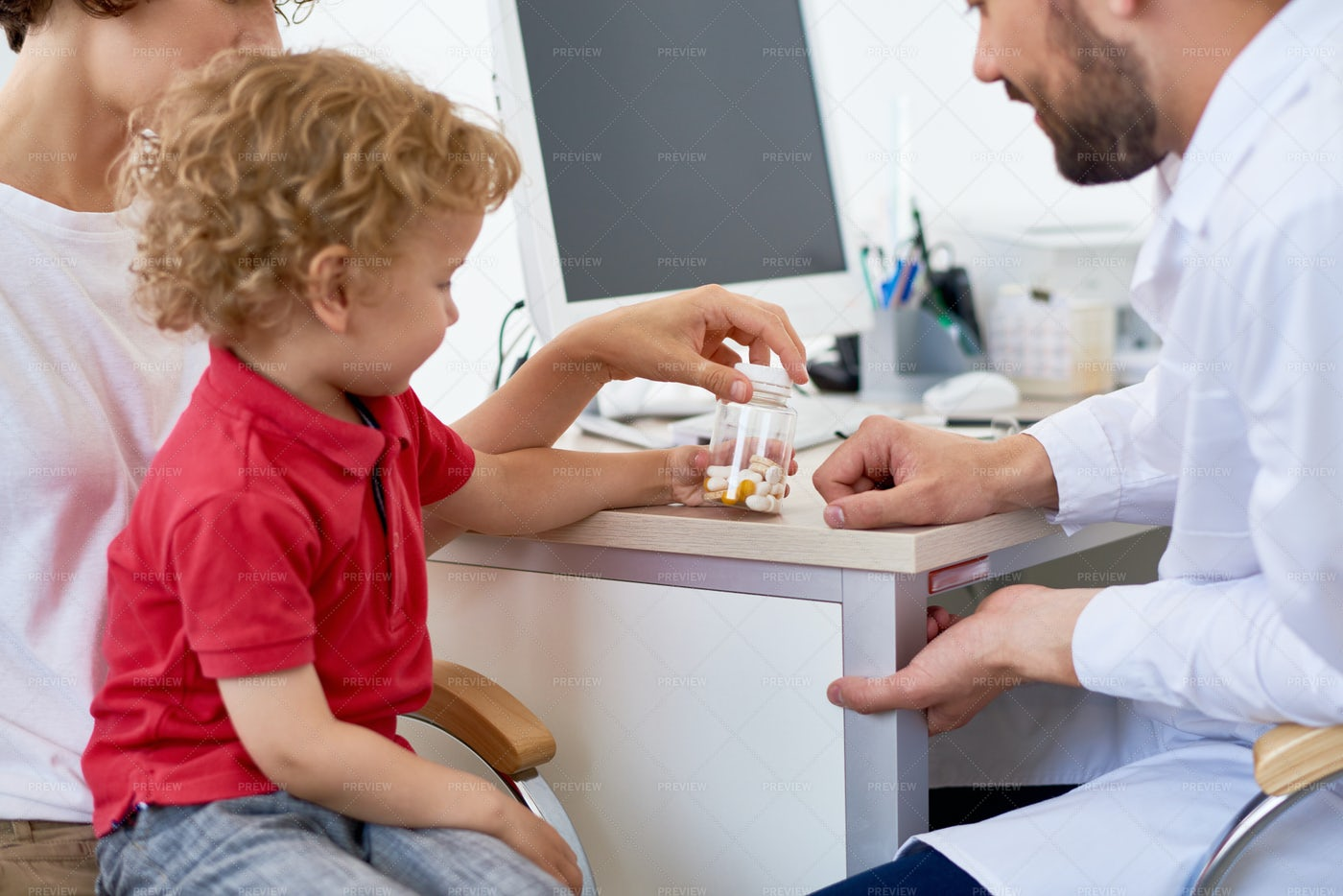 Boy Holding Bottle Of Vitamins: Stock Photos