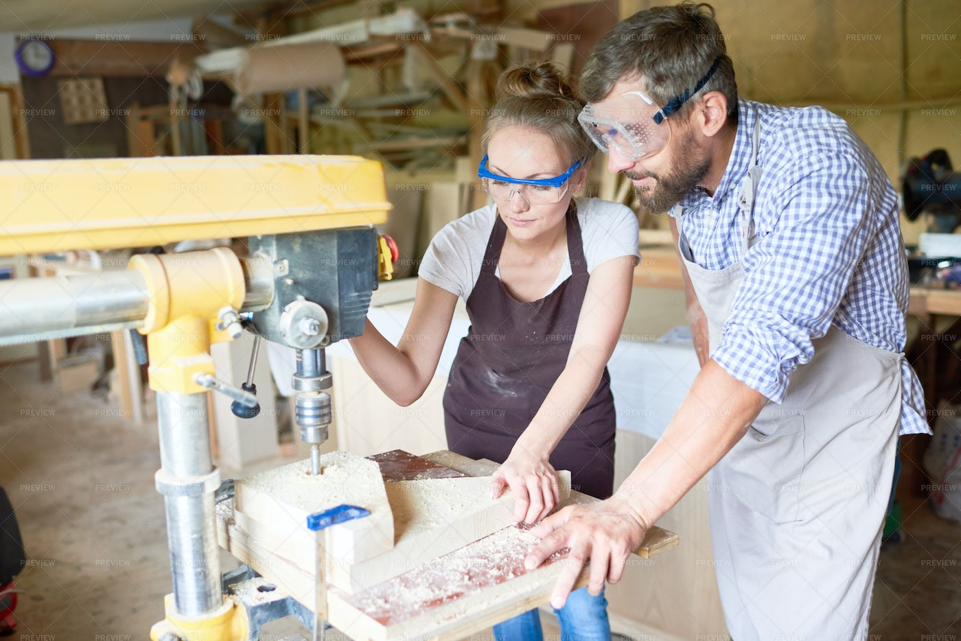 Two Carpenters In Workshop: Stock Photos