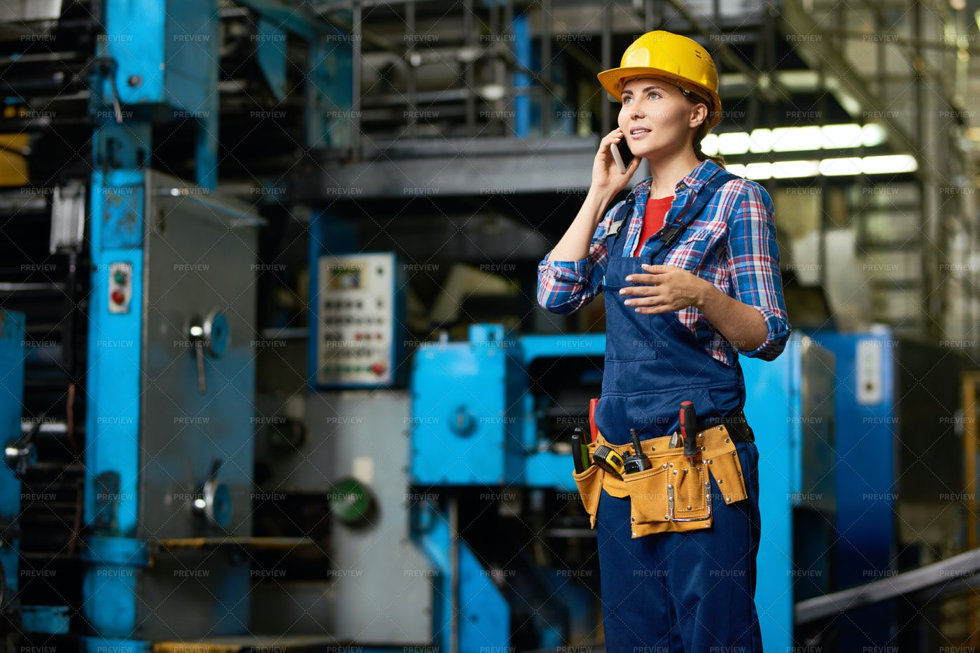 Female Worker Speaking By Phone In...: Stock Photos
