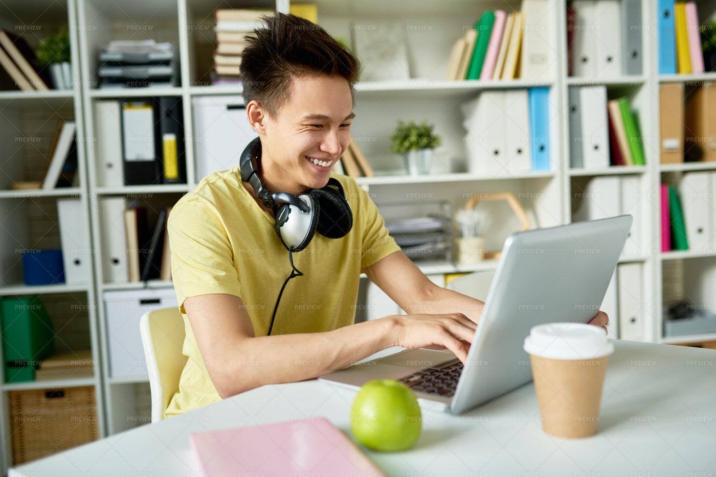 Happy Asian Student Using Laptop: Stock Photos