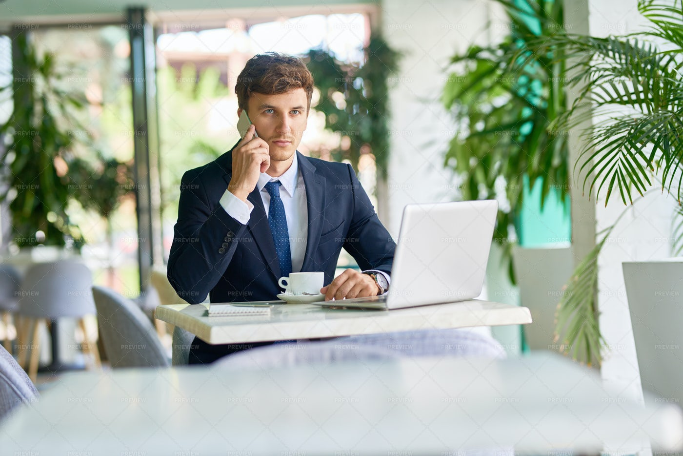 Contemporary Businessman Working In...: Stock Photos