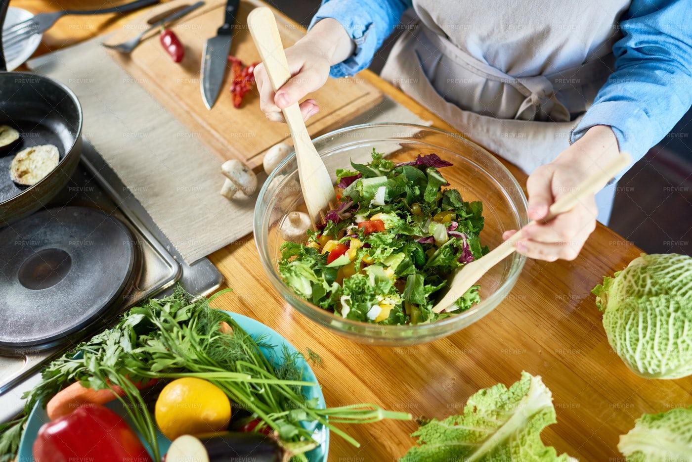 Housewife Making Salad Close Up: Stock Photos