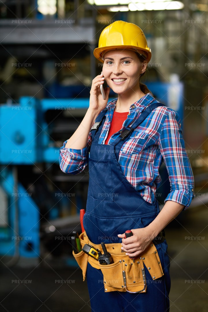 Young Woman Speaking By Phone In...: Stock Photos