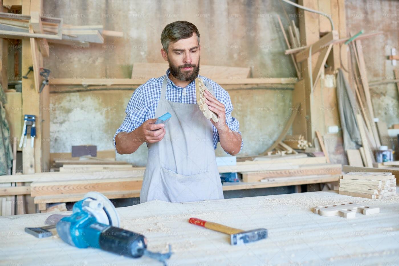 Skilled Carpenter Sanding Wooden...: Stock Photos