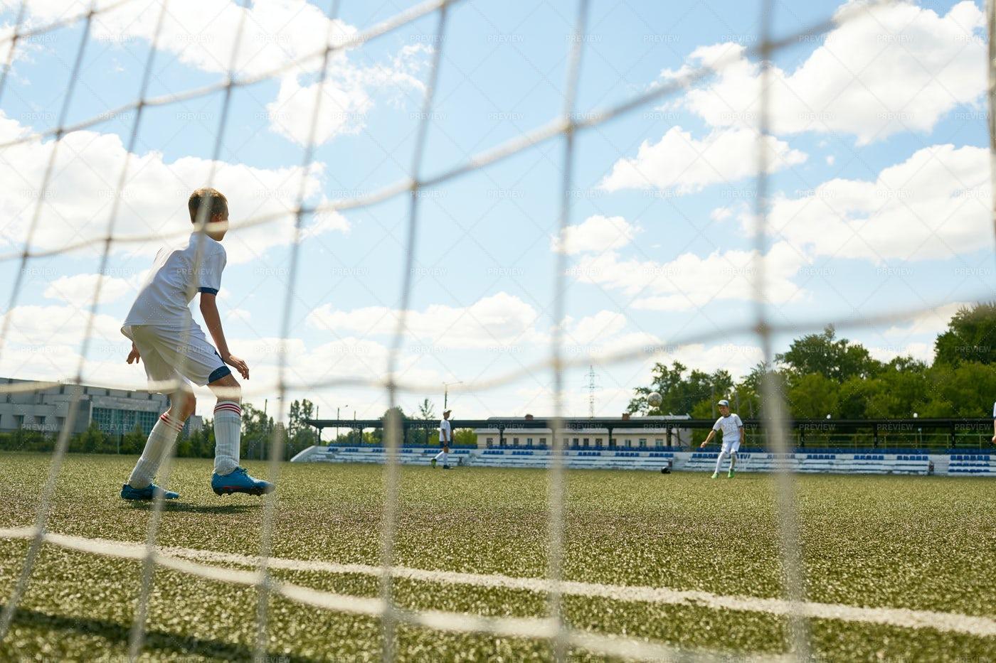 Junior Football Team At Practice: Stock Photos