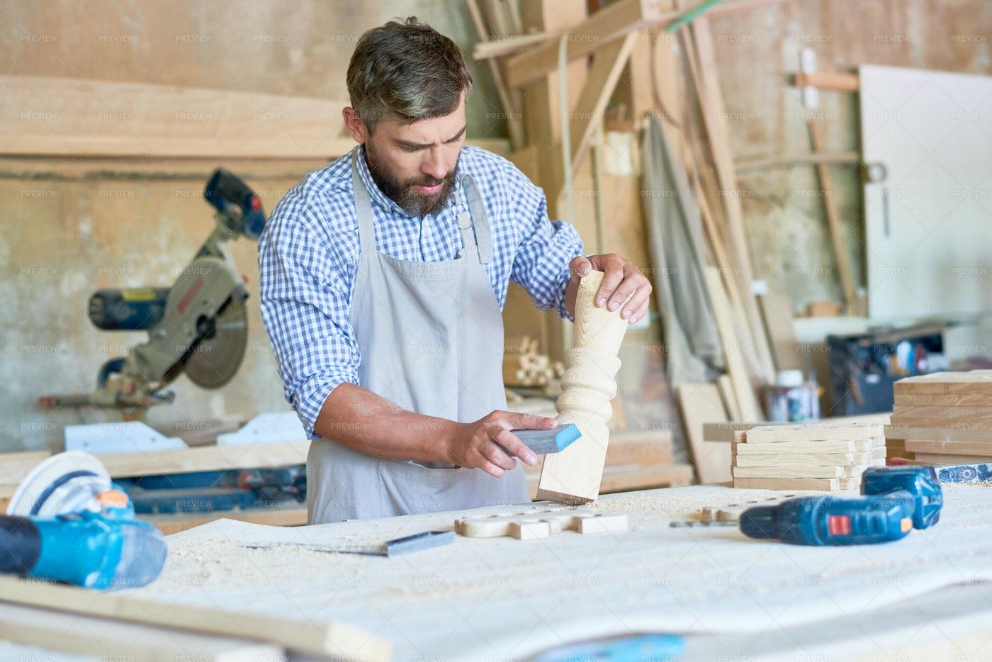 Bearded Carpenter Sanding Stair...: Stock Photos