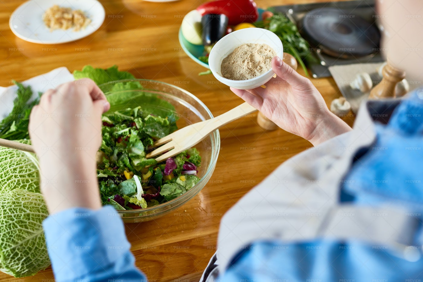Adding Seasoning To Salad: Stock Photos