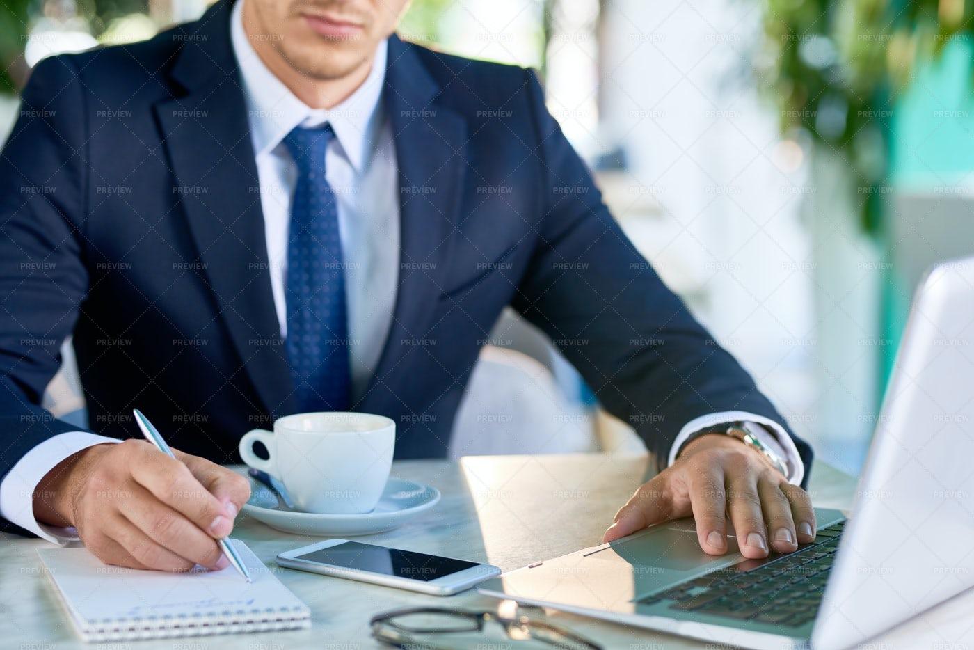Elegant Businessman Working At Desk: Stock Photos