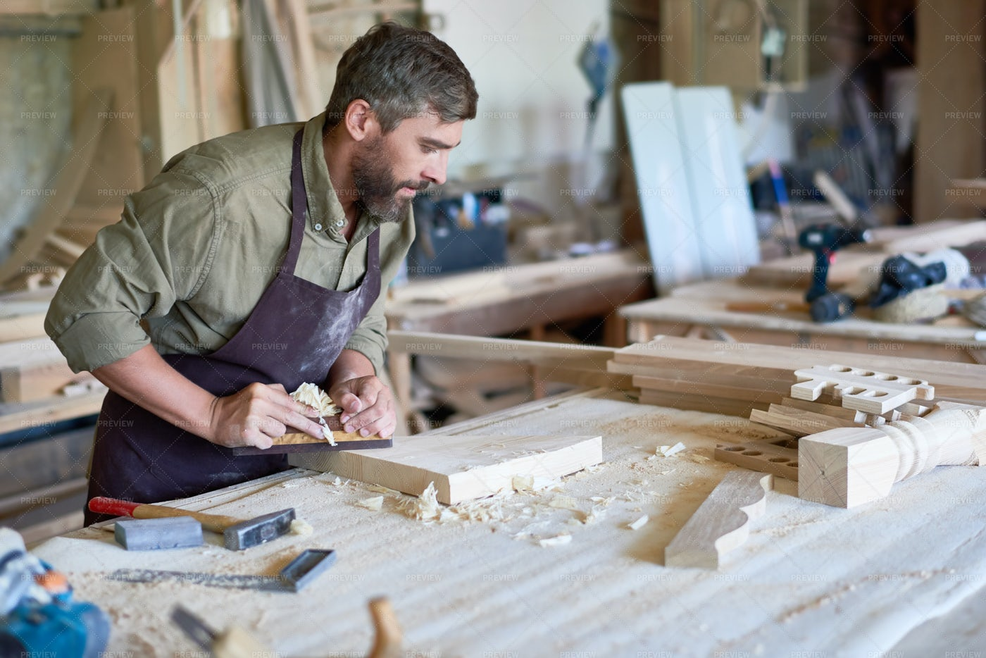 Bearded Carpenter Working With Wood...: Stock Photos