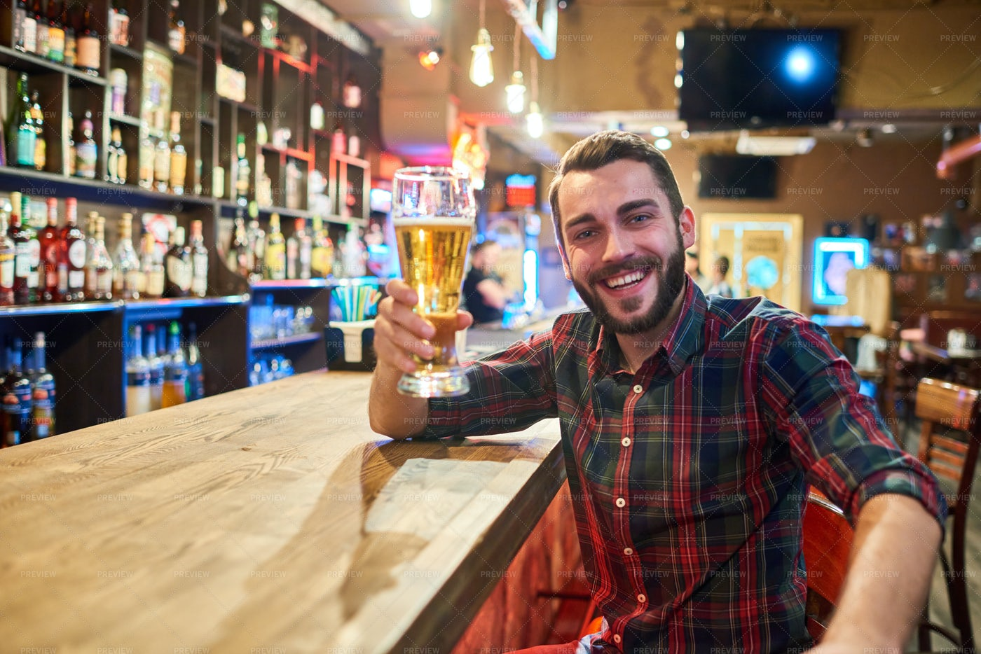 Happy Young Man Posing At Bar...: Stock Photos