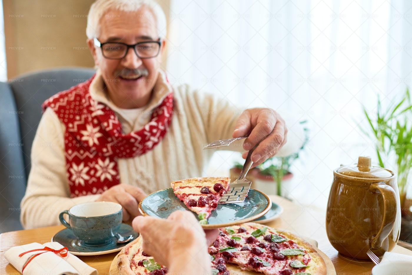 Senior Man Eating Sweet Pie At...: Stock Photos