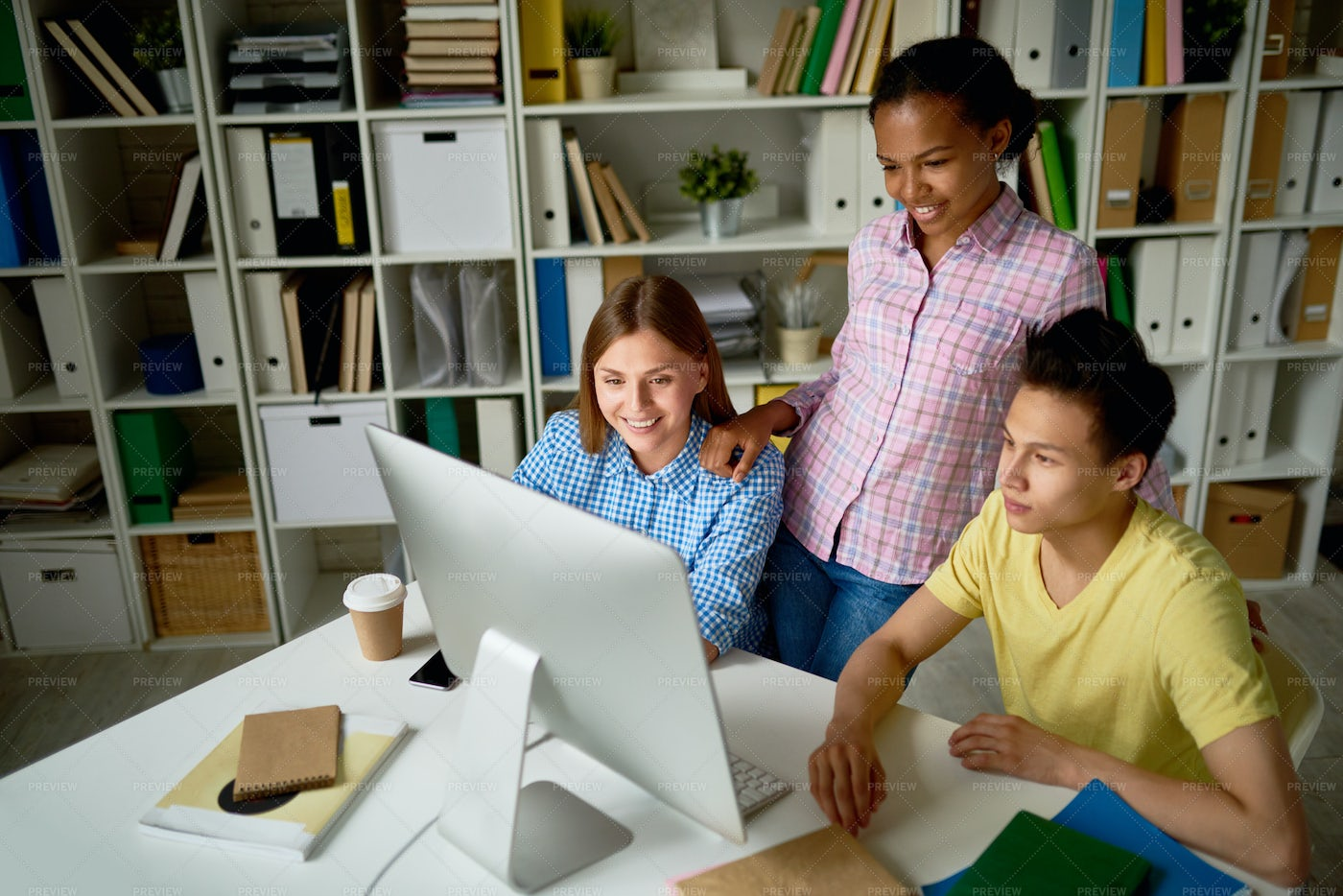 Young People Working In Library: Stock Photos