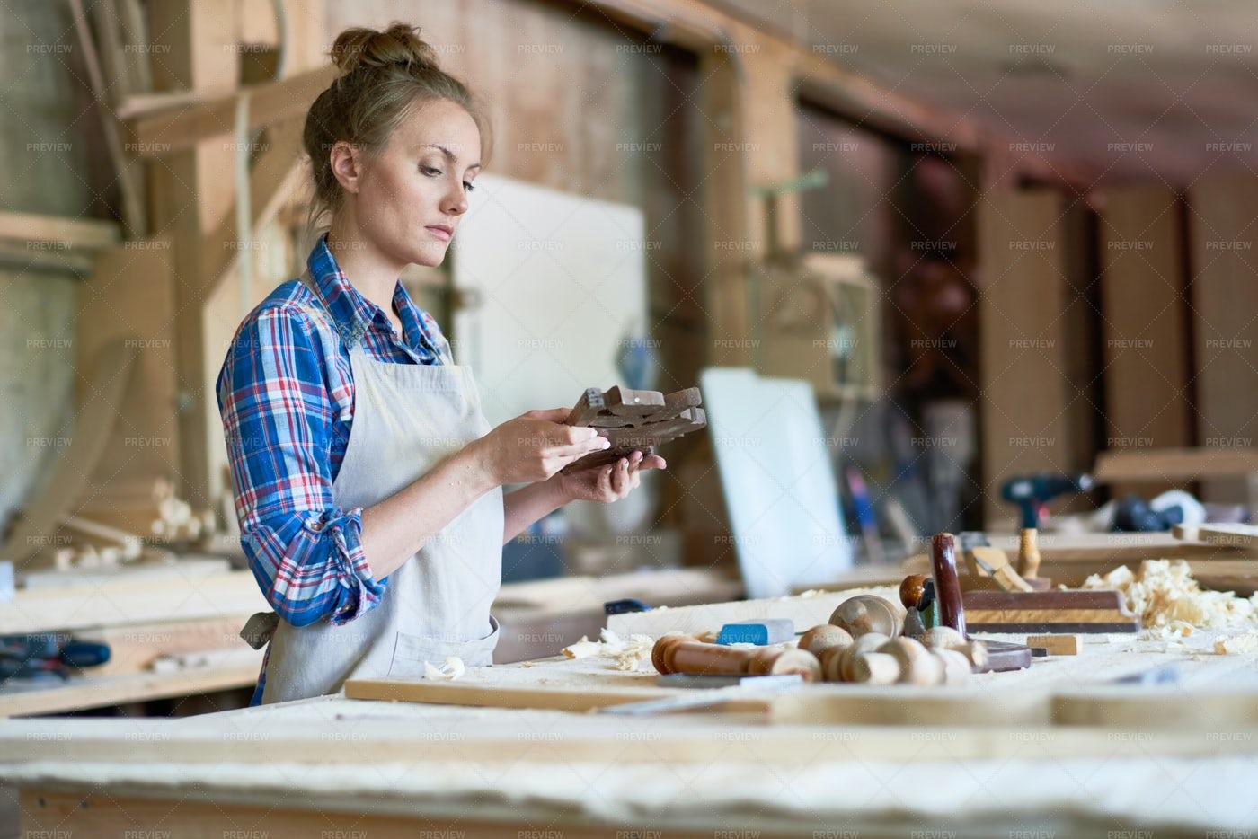 Female Carpenter Holding Wooden...: Stock Photos