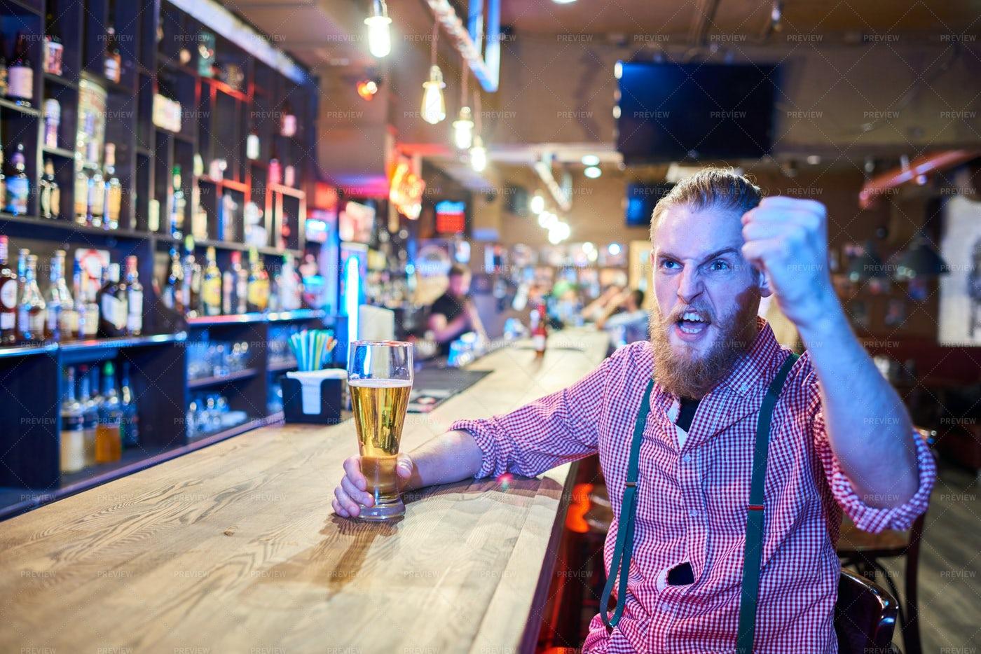 Sports Fan Watching Match In Pub: Stock Photos