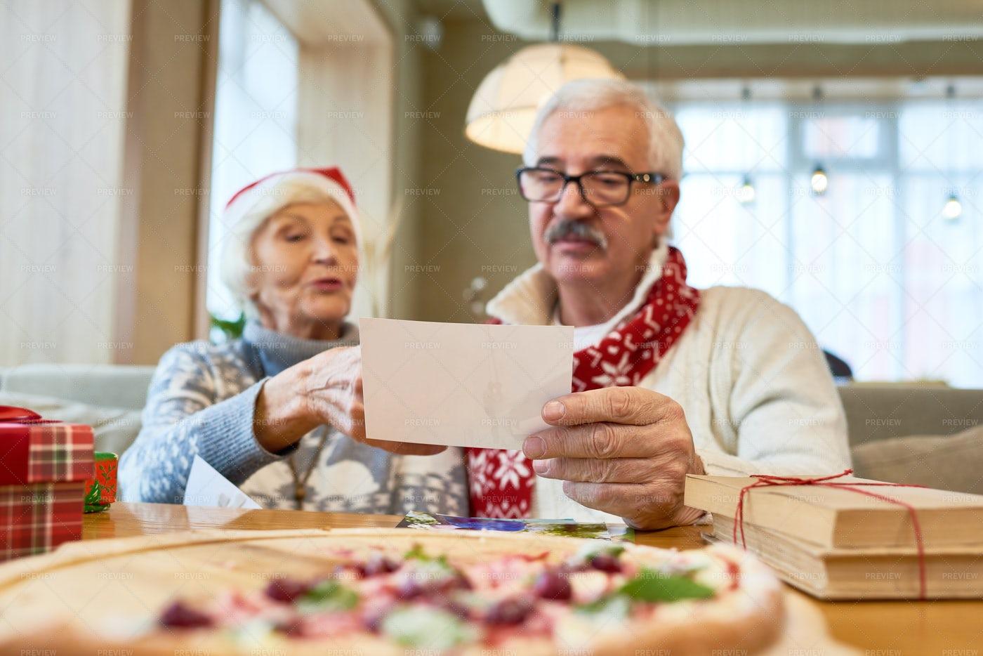 Senior Couple Looking At Family...: Stock Photos