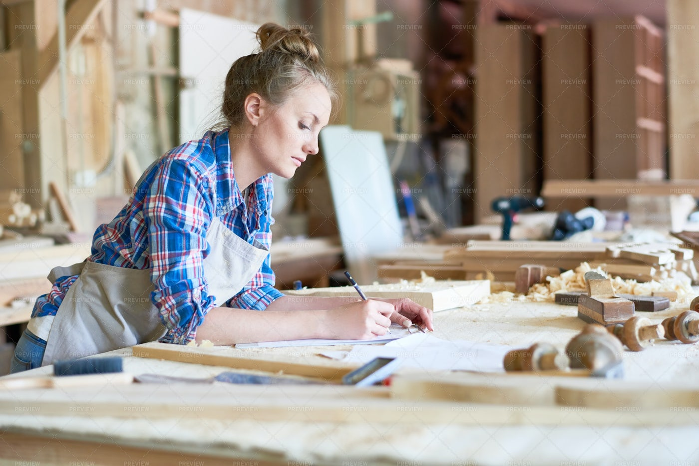 Female Joinery Manager In Workshop: Stock Photos