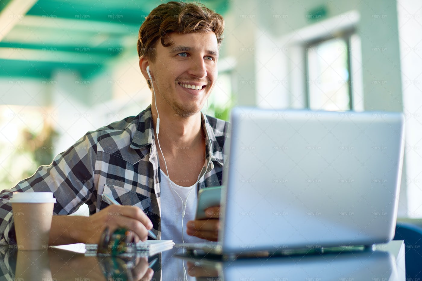 Happy Young Man Working At Creative...: Stock Photos