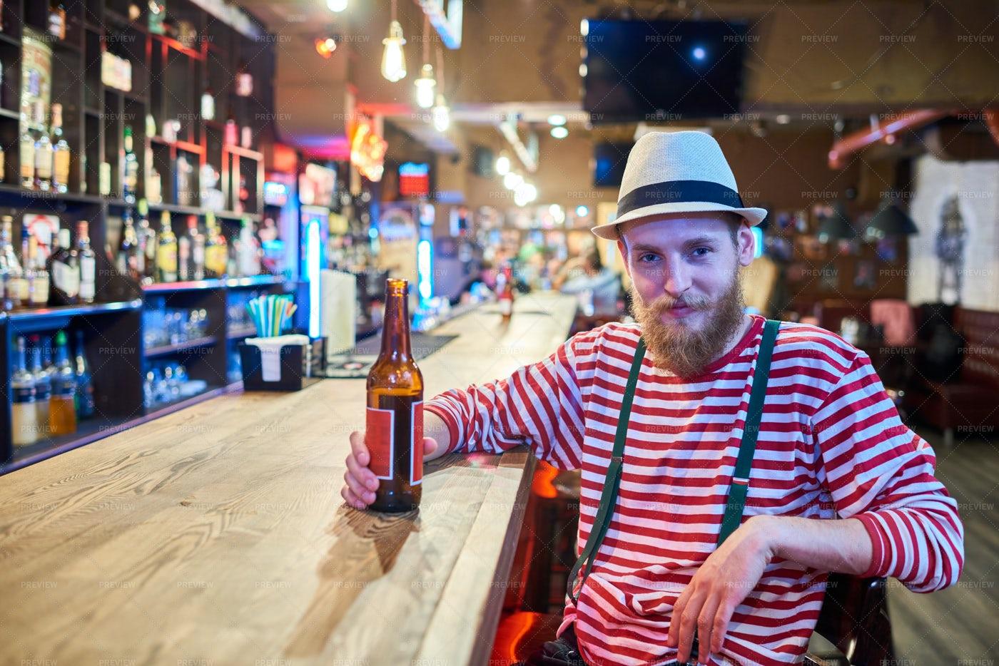 Bearded Young Man Chilling In Bar: Stock Photos