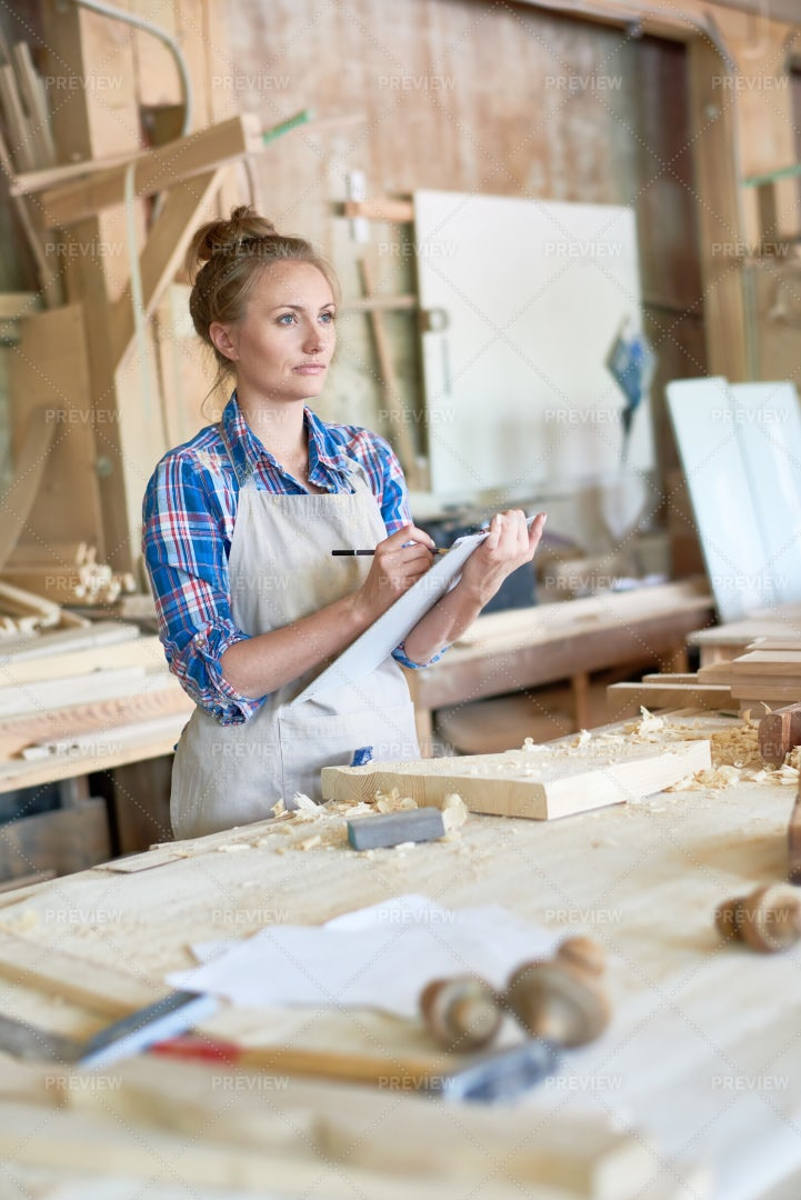Woman Holding Clipboard In...: Stock Photos