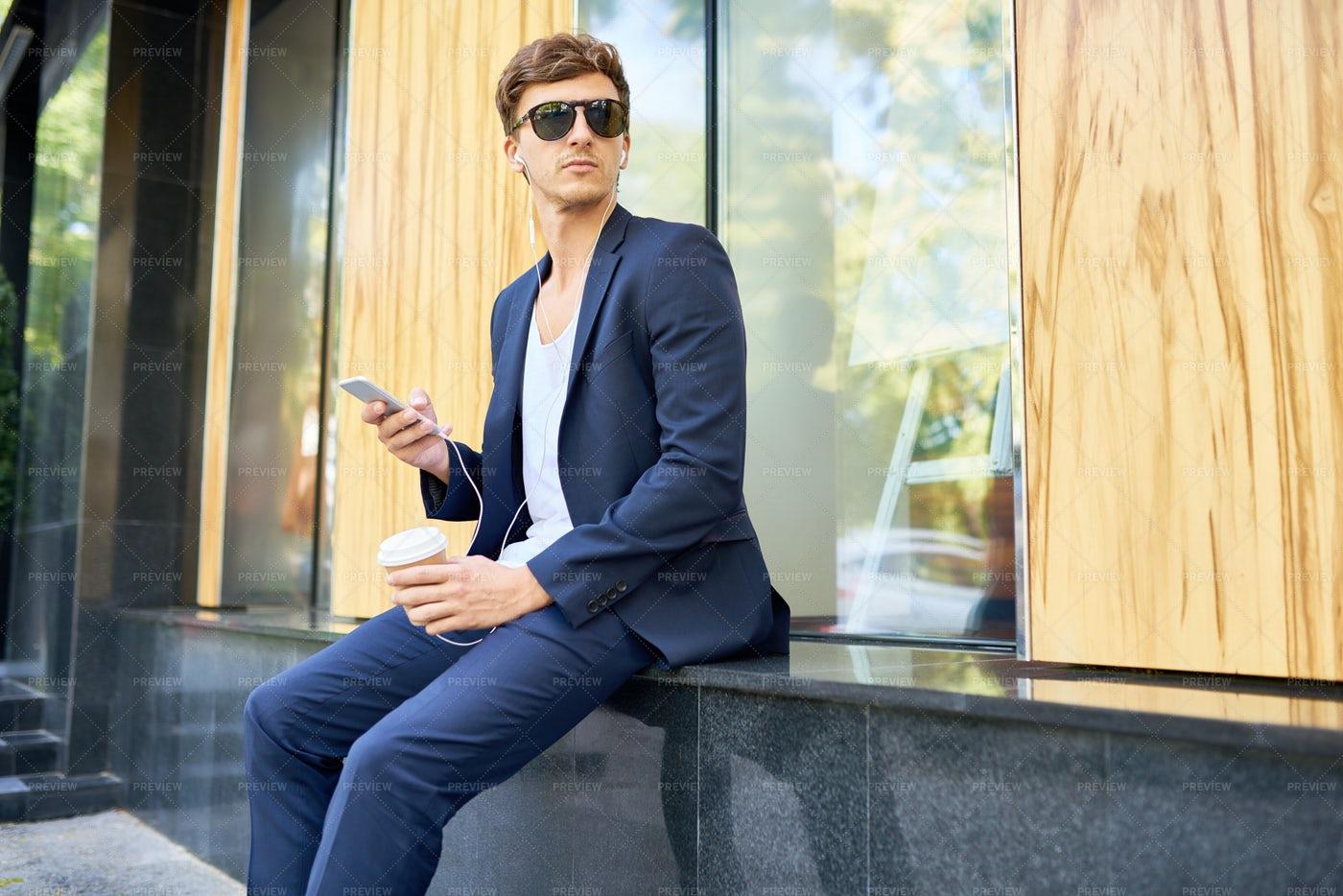 Stylish  Handsome Man Holding...: Stock Photos