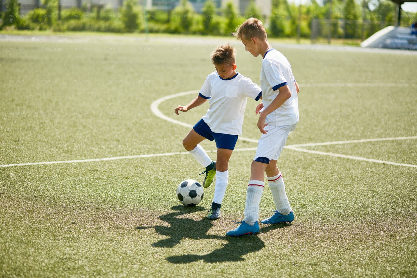 Boys Fighting For Ball In Football: Stock Photos
