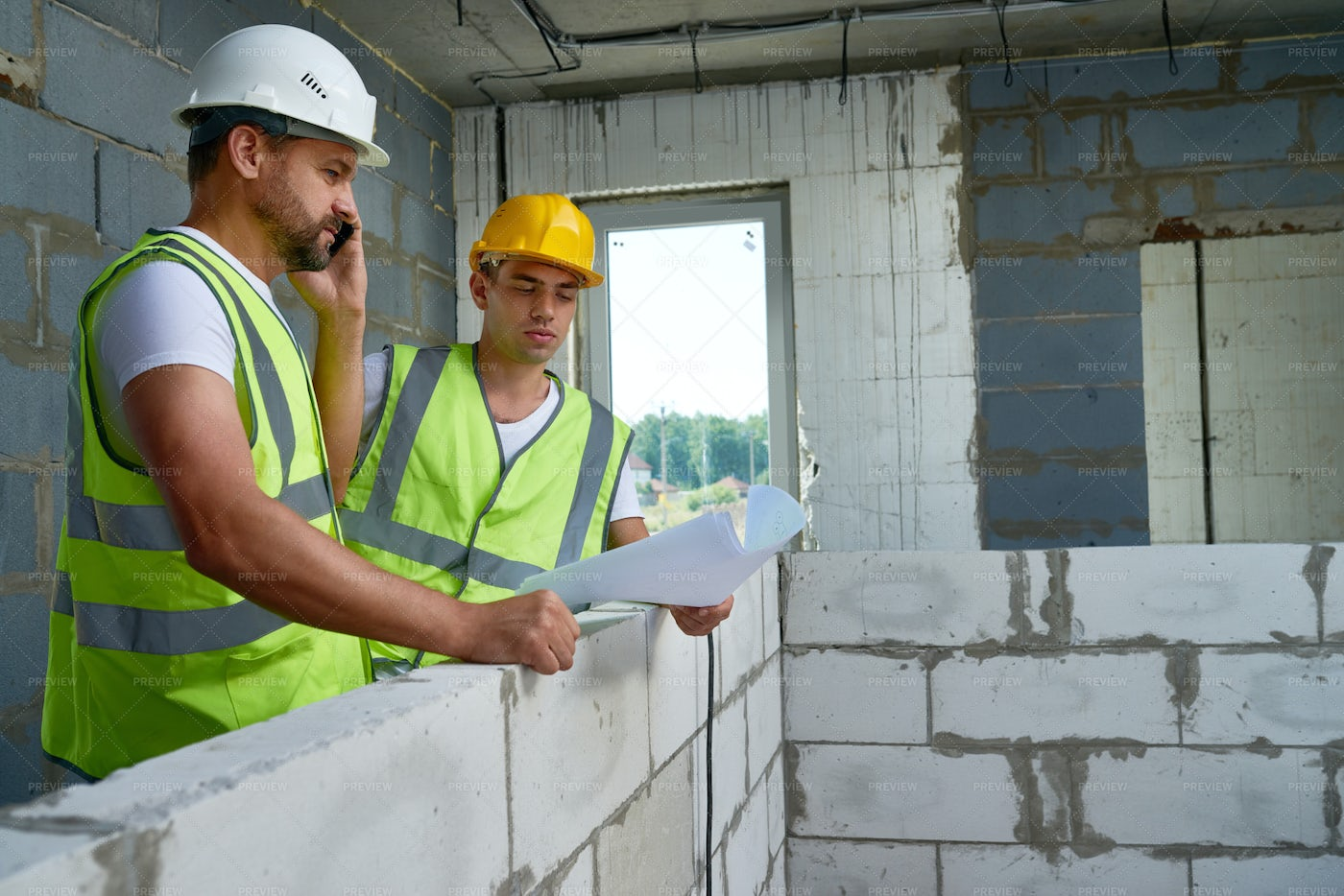 Two Workers With Floor Plans: Stock Photos
