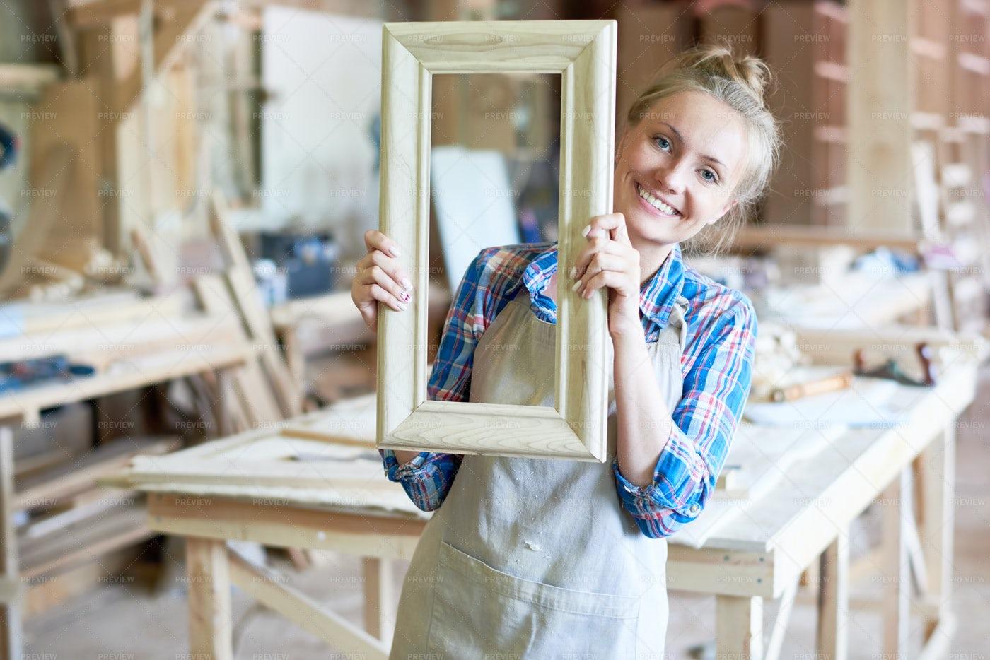 Cheerful Female Carpenter Posing In...: Stock Photos