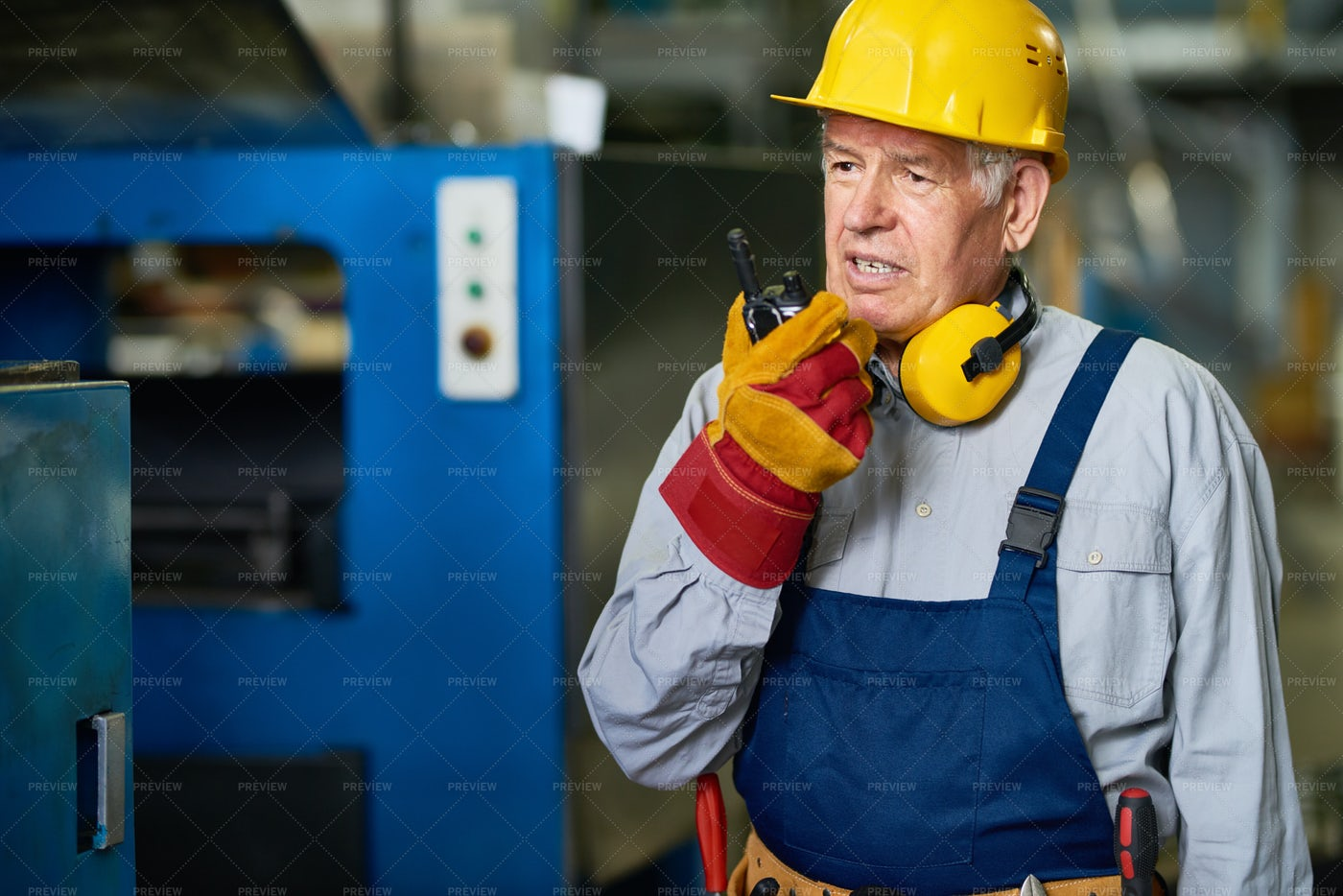 Factory Foreman Speaking By Radio...: Stock Photos