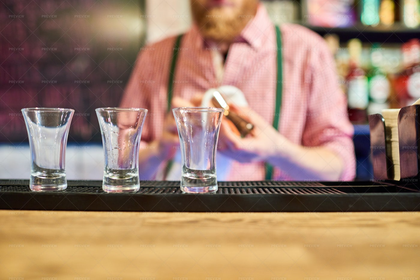 Bartender Cleaning Up At Bar...: Stock Photos