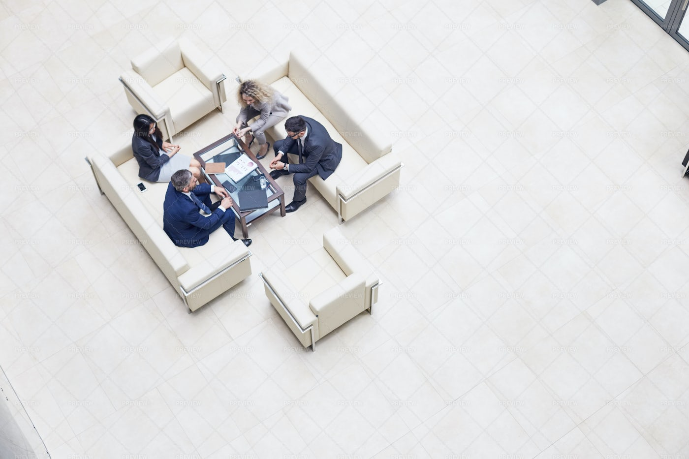 Working Meeting At Office Lobby: Stock Photos