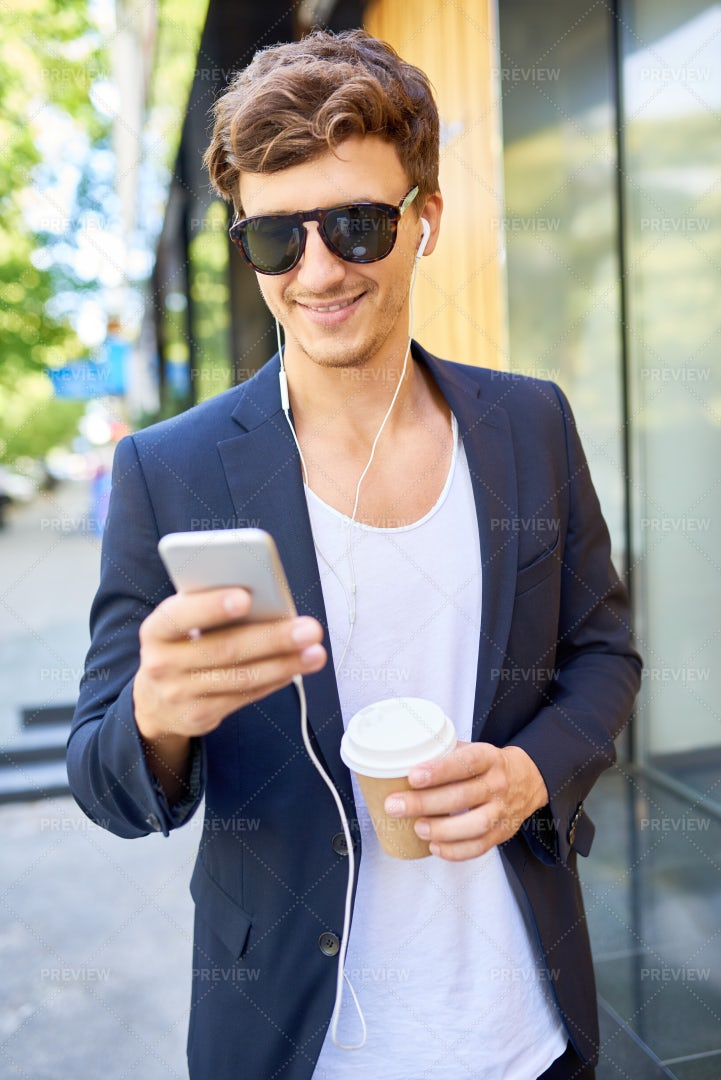 Stylish Young Man Listening To...: Stock Photos