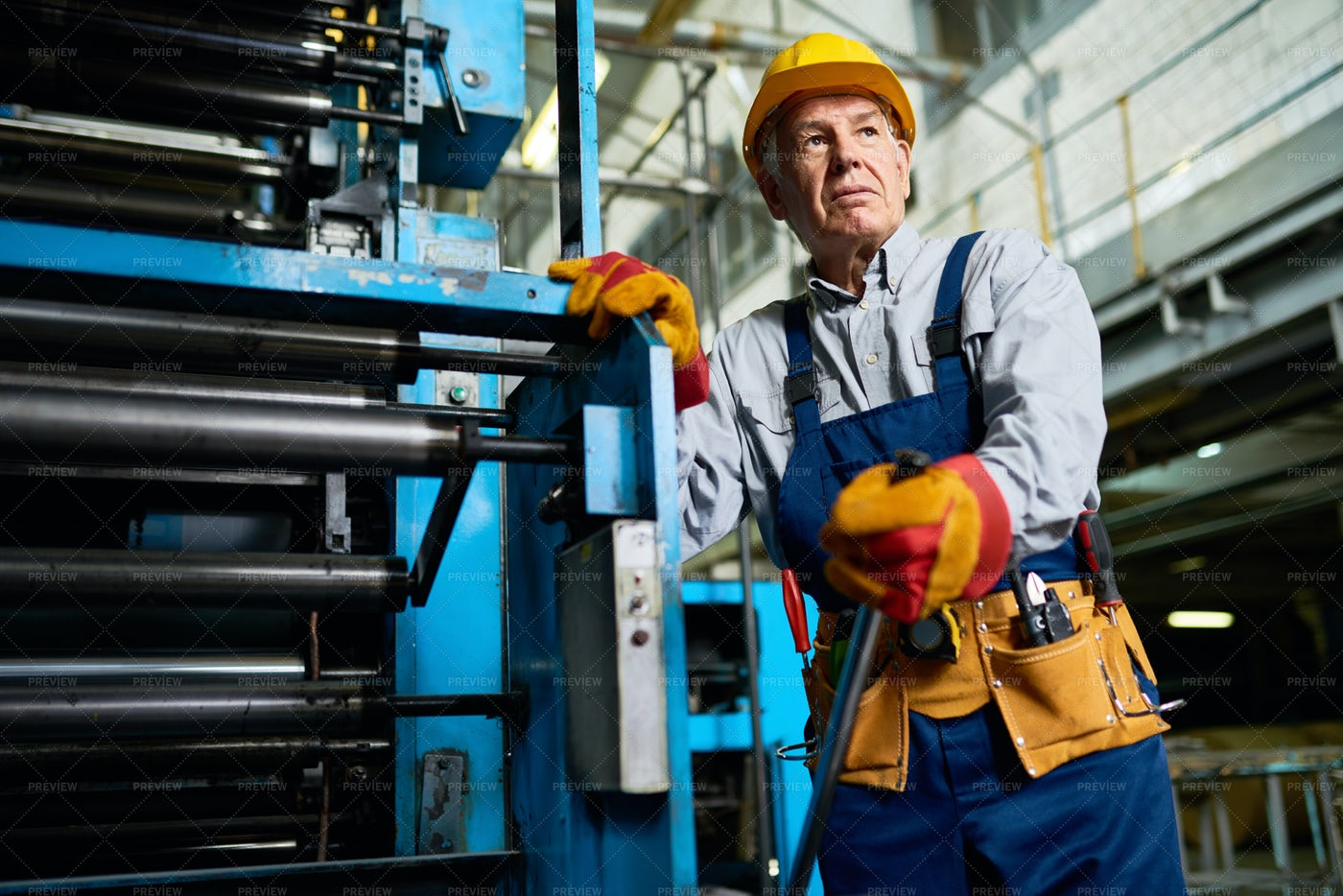 Senior Worker Operating Machines At...: Stock Photos